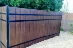 Steel and wood privacy fence