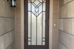 Artisan Series Security Door, FLW V2 finished in Copper Vein.