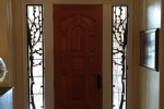 Custom Iron tree side lights and transom window guards.