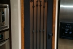 Custom pantry or wine cellar iron door.