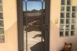 Full View Series Iron storm door, Diamond design in flat brown